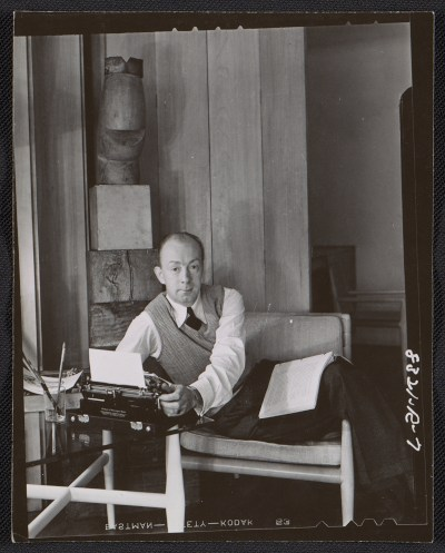 [Terence Robsjohn-Gibbings sitting with a typewriter]