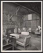Living room with furniture designed by T.H. Robsjohn-Gibbings