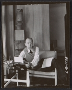 Terence Robsjohn-Gibbings sitting with a typewriter