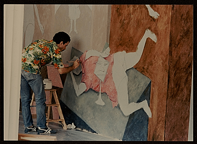 [Arturo Rodríguez painting his mural, The Great Theater of the World]