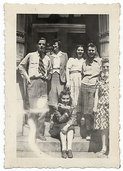 [Esther Rolick and group on front stoop]