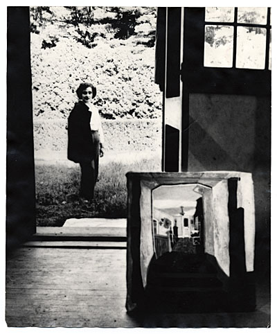 Esther Rolick seen through a window