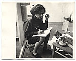 Esther Rolick sitting with sketchbook