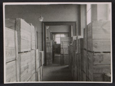 [Storage rooms inside Museum Wiesbaden filled with wooden crates]