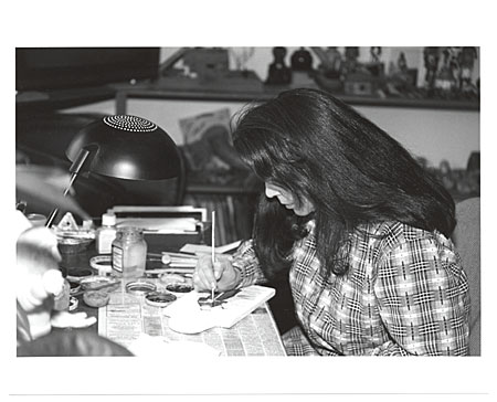 Catherine Robles-Shaw working at desk