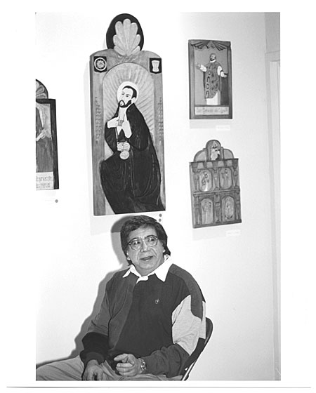 José Raul Esquibel sitting by his works