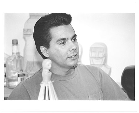 Jerome Lujan with work, head shot