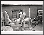 Leroy Archuleta with wooden elephant sculpture