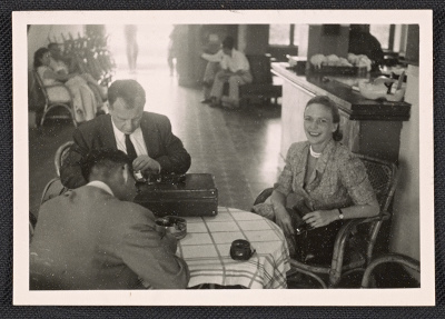 Aline B. Saarinen seated at a table
