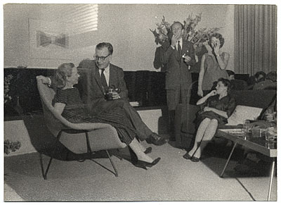[Aline and Eero Saarinen at a party]