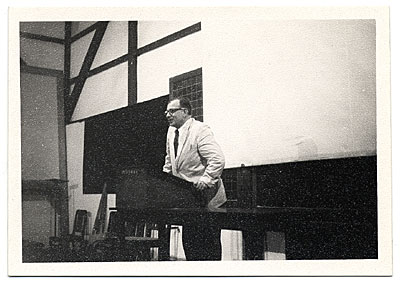 Eero Saarinen speaking from a podium