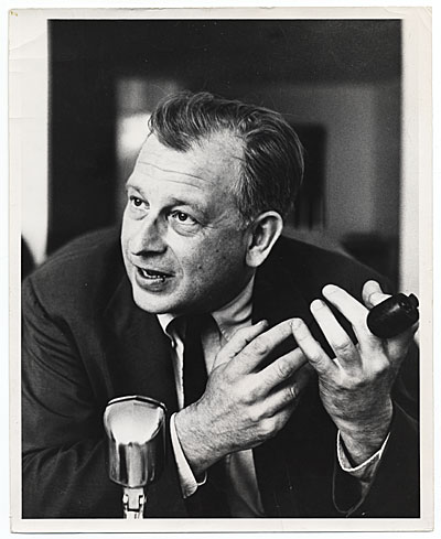 Eero Saarinen speaking into a microphone