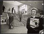 Aline B. Saarinen holding a picture of Eero Saarinen