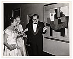 Aline and Eero Saarinen in formal dress with a Picasso painting
