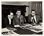 Eero Saarinen and two unidentified men, review designs