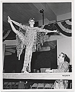 Woman in costume on stage at the Museum of Merchandise