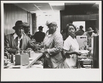 Waitresses and customers at Adele's Place, Harlem, New York