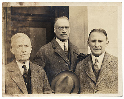 W.E. Schofield and two unidentified men