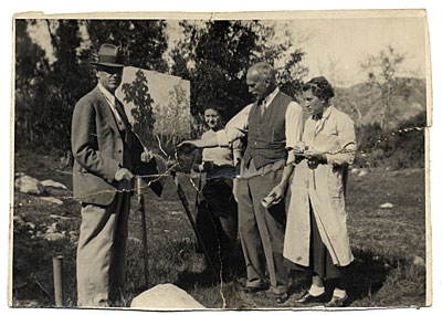[W.E. Schofield outdoors with his art class.]