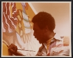 Charles Searles at work on a painting
