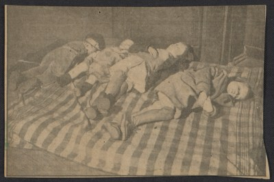 Newspaper clipping featuring sleeping children
