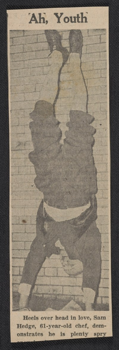 Newspaper clipping featuring a man performing a handstand