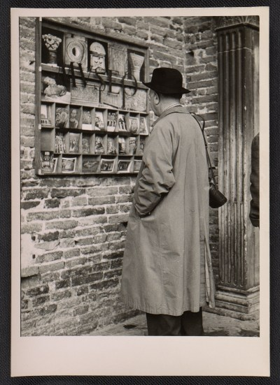 [Ben Shahn looking at postcards]