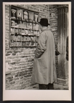 [Ben Shahn looking at postcards ]