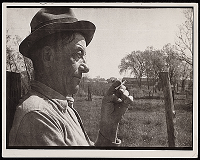 Source material for Tribute to the American Working People. Profile of a man smoking