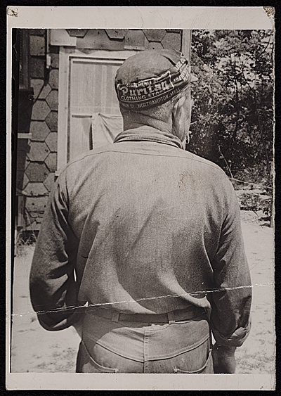 [Source material for Tribute to the American Working People.  Back view of man with a cap]