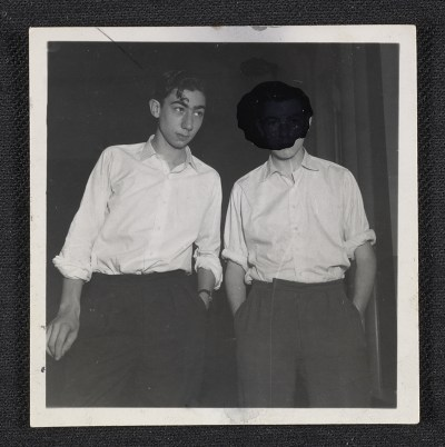 Two teenage boys with their hands in their pockets