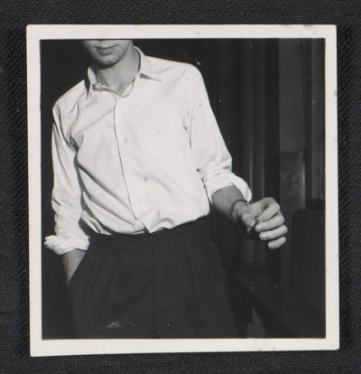 Unidentified teenage boy with one hand in his pocket