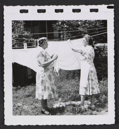 Women hanging laundry