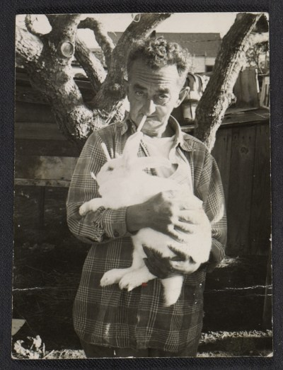 [Man holding a rabbit]