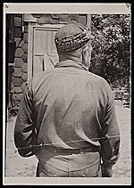 Source material for Tribute to the American Working People.  Back view of man with a cap