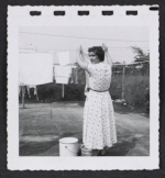 [Women hanging laundry 2]
