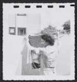 [Women hanging laundry 3]