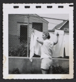 [Women hanging laundry 5]