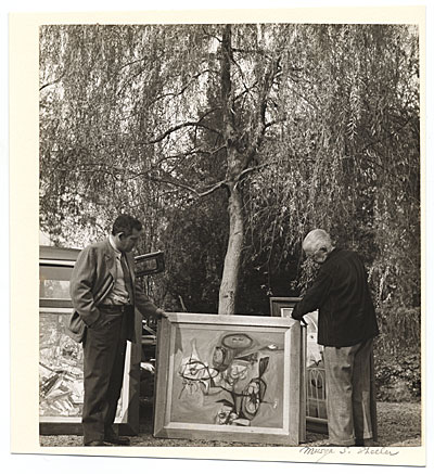 [Charles Sheeler and Bill Lane outdoors with a painting]