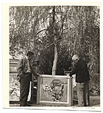 Charles Sheeler and Bill Lane outdoors with a painting