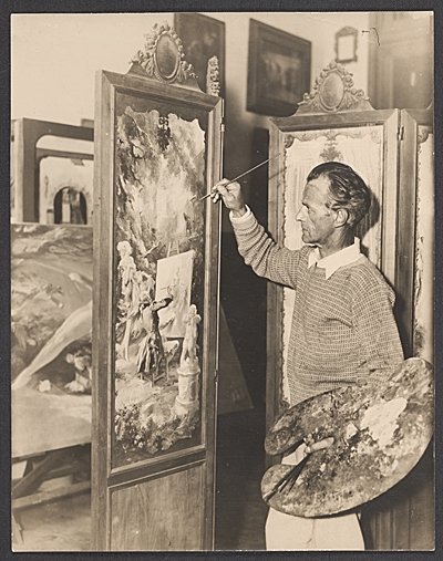 Everett Shinn painting a folding screen