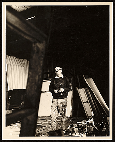 [Hassel Smith painting in studio]