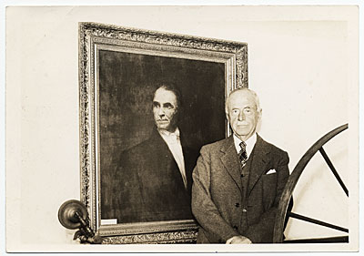 [Joseph Lindon Smith with his painting]