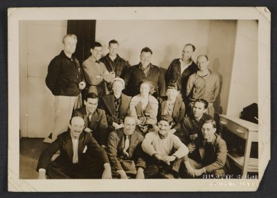 Vernon Smith (seated on the floor all the way on the right) and others in Alaska