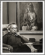 Moses Soyer seated near a painting