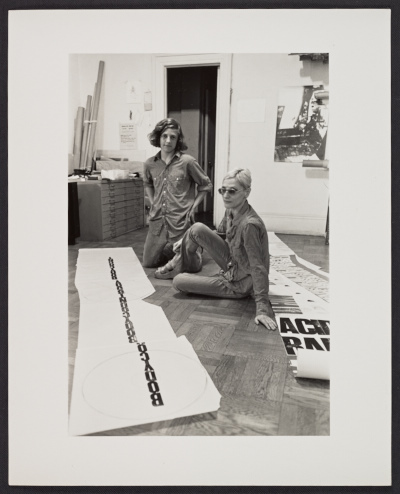 [Nancy Spero in her studio with her son, Paul Golub]