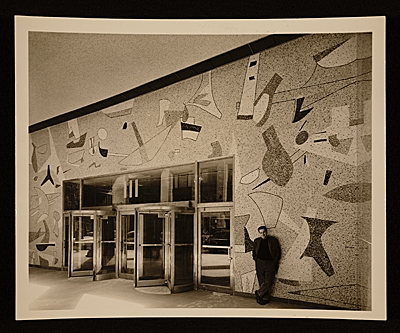 Max Spivak standing in front of his Union Dime Bank mosaic