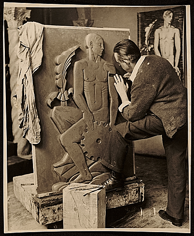 [John Storrs working on a plaster model]