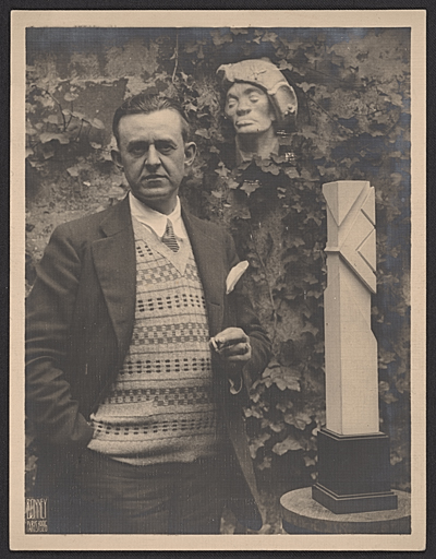 [John Storrs with one of his sculptures]