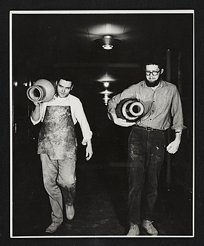 Paul Suttman carrying a pot at Cranbrook Academy of Art